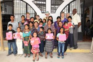 The grade 1 to 6 students with their parent, valentine and some of the Paso directors/members.